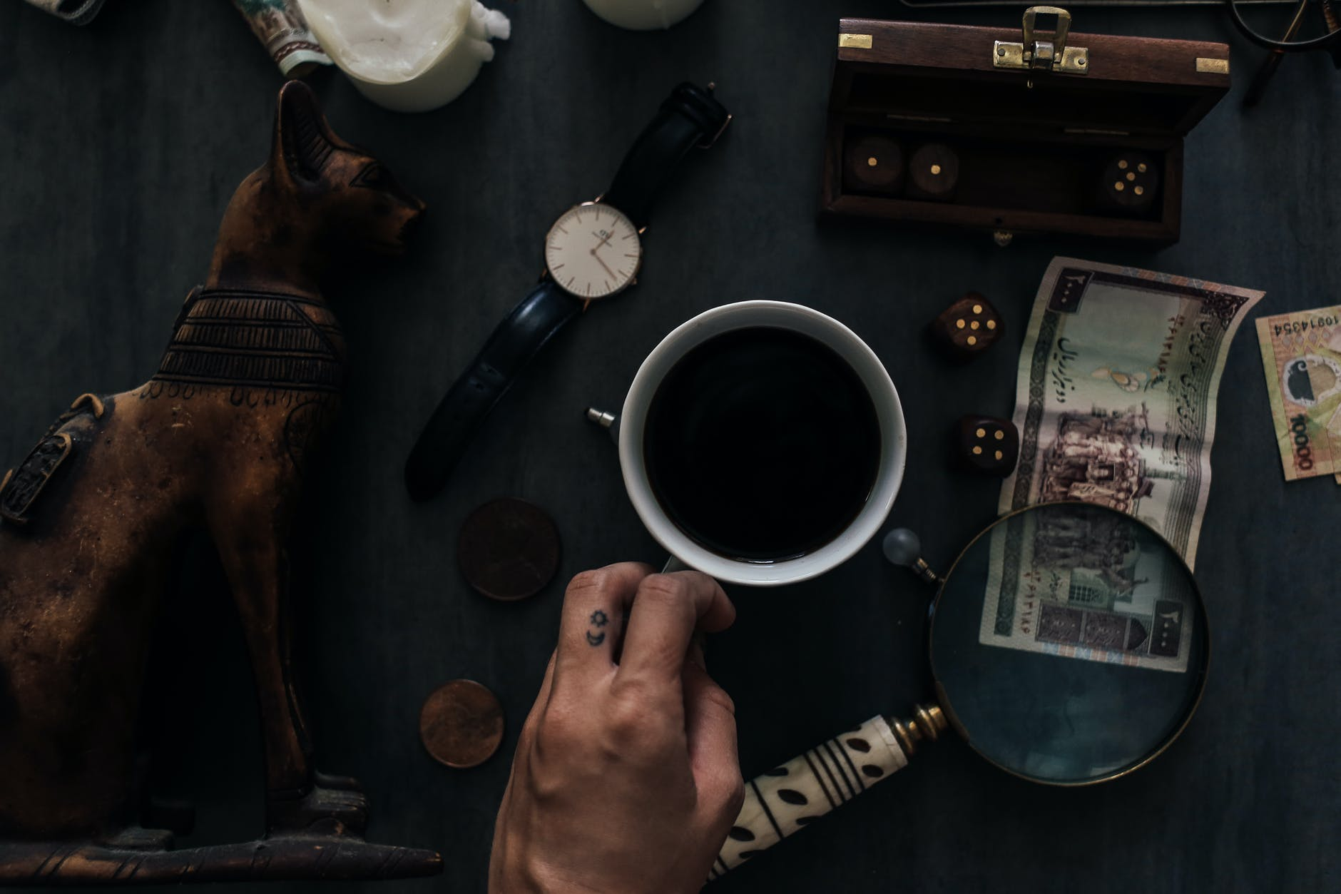 man with coffee at table with old fashioned items