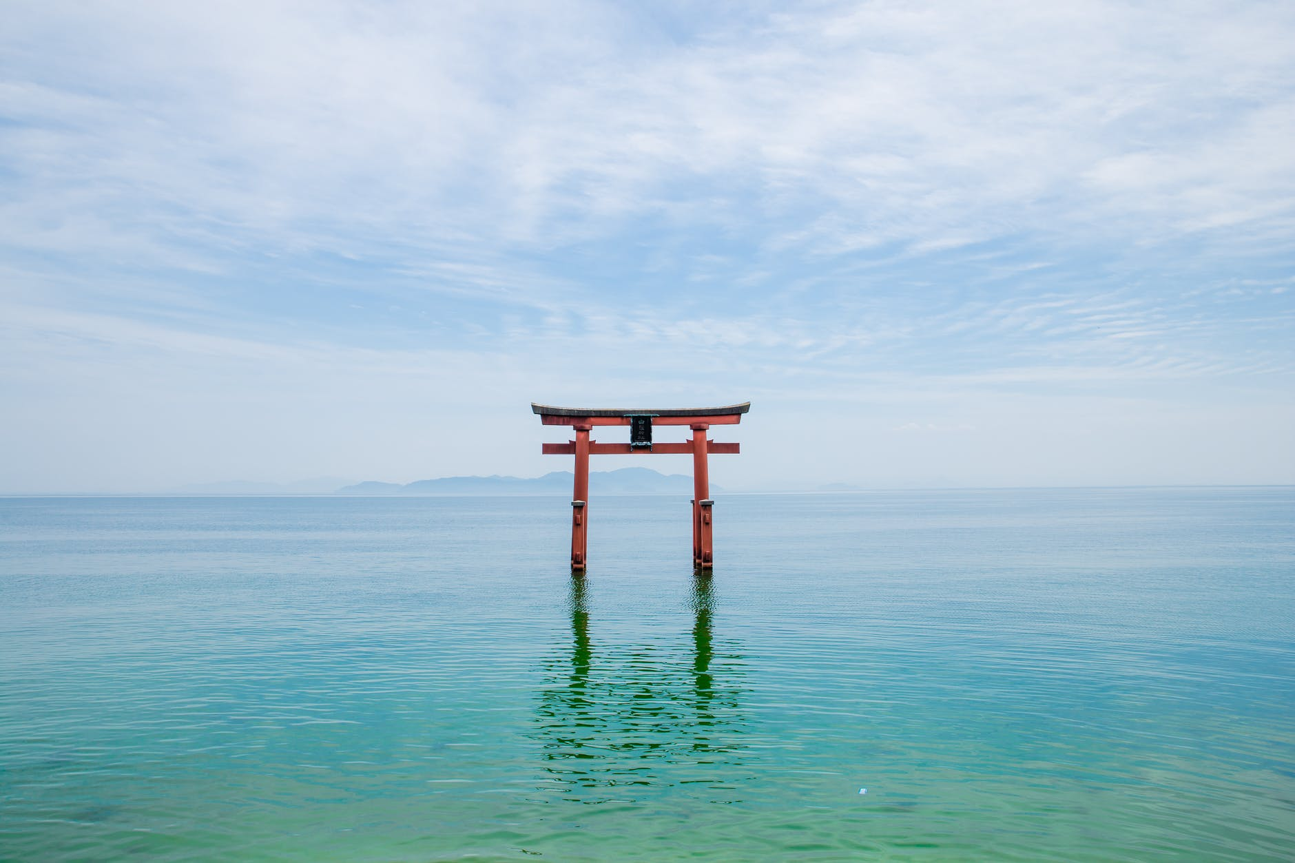 shinto shrine in blue lake in japan